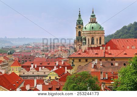 Beautiful Cityscape And St Nicholas Church Dome Above Red Roof Tops Of Mala Strana, Prague, Czech Re