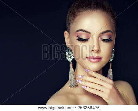 Beautiful Model Girl With Pearl Manicure On Nails . Fashion Makeup And Cosmetics . Large Earrings Ta