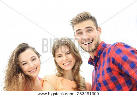 closeup of three young people smiling on white background