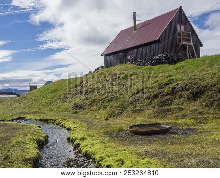 Red Roof Wooden Mountain Hut Strutur Maelifellssandi Near Road F210 In Iceland Natue Reserve Fjallab
