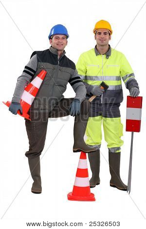 two road workers posing together