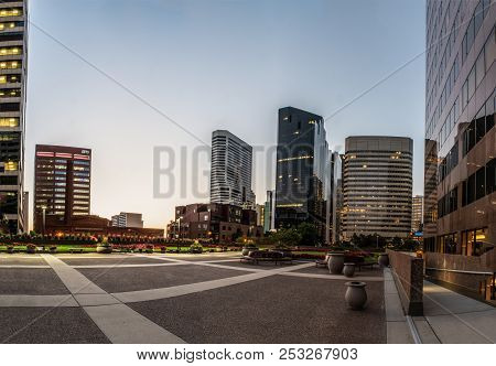 Downtown District Of Denver, Colorado Showing Tall Buildings And 2nd Floor Greenbelt Park Area On Au