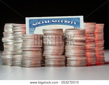 Many Stacks Of Old Silver Dimes With Social Security Card To Illustrate Trust Fund