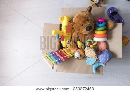 Box Of Toys On The Floor. Teddy Bear In Box, Vintage Tone. Charitable Contribution. Donation. Benefi
