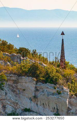 Nautical Navigation Post On Cliff On Croatian Island Solta