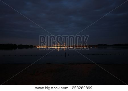 The Nesselande Beach And District Lights In The Evening Is Reflecting On The Water Of The Zevenhuize