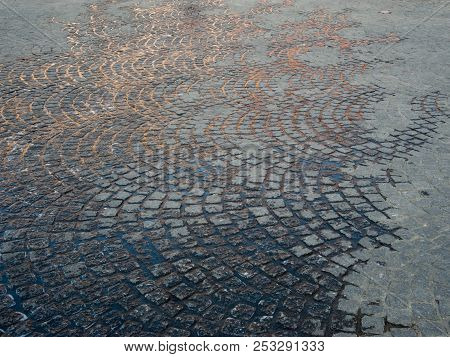 Wet Cobblestones In A Circular Pattern In Europe