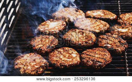 Preparing Delicious Hamburgers On The Outdoor Grill For Family Lunch. Conceptual Picture Of Grilled