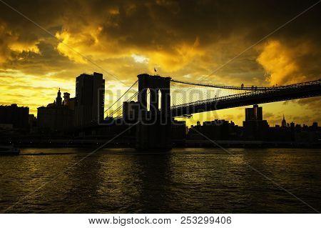 New York City Manhattan Skyline And Brooklyn Bridge At Sunset