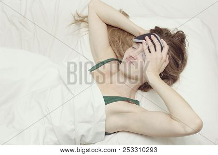 Young Woman In A Mask For Sleep Does Not Want To Wake Up