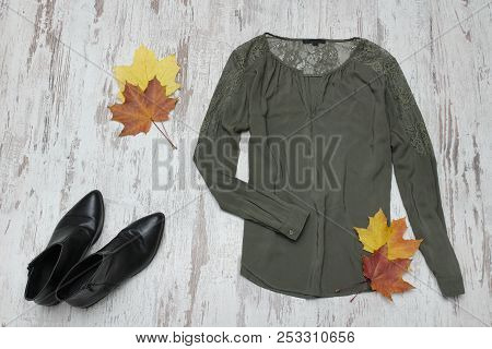 Green Blouse, Black Shoes And Maple Leaves. Fashionable Concept.