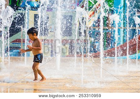 Pataya, Thailand - 01 July 2016 - A Boy Enjoy Playing With Floor Water Fountain At Cartoon Network W