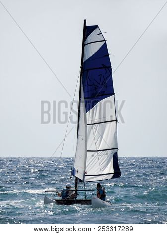 Cannes, France - July 2, 2018: Sailing Catamaran In The Mediterranean Sea. Unidentified People Are S