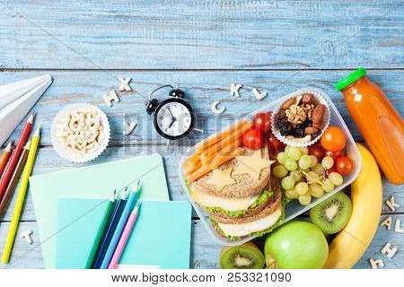 Back To School Concept. Healthy Lunch Box And Colorful Stationery On Turquoise Wooden Table Top View
