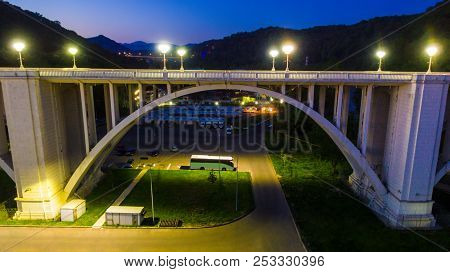 Drone View Of The Illuminated Matsesta Viaduct And The Parking Under It On The Background Of Mountai