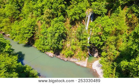 Drone View Of The Sochi River Gorge With Dense Forest And Orekhovsky Waterfall In Sunny Summer Day,