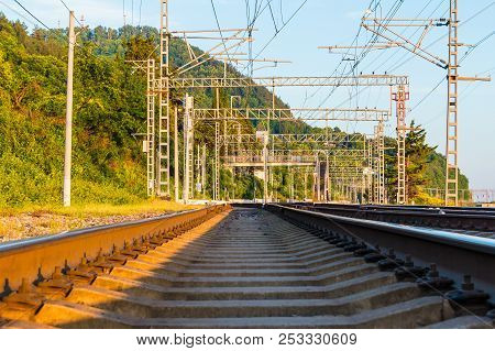 Low-angle View Of The Railroad Going Into The Distance On The Background Of Mountain In Sunny Day, S