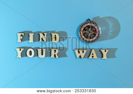 Inscription Find Your Way And Compass On A Blue Background. Concept Of Asserting Oneself In Life And