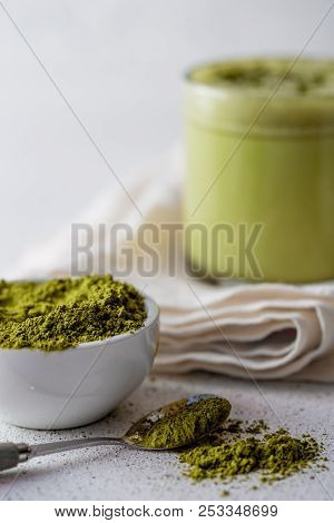 BULLETPROOF MATCHA. Ketogenic keto diet hot drink. Tea matcha blended with coconut oil and butter. Cup of bulletproof matcha and ingredients on white background poster