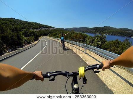 Woman Riding A Bike On Mljet Island, Croatia. Near Sea And Mountains In Summer. Female Rider Cycling