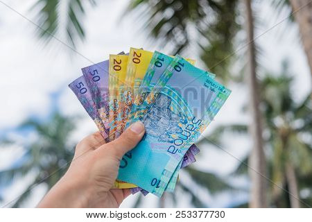 Samoan Tala Currency (wst) - Left Hand Holding Colorful Bank Notes From Western Samoa In South Pacif