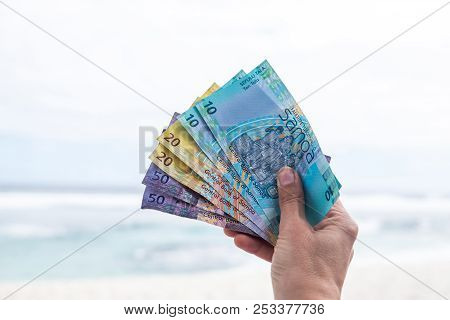 Samoan Tala Currency (wst) - Right Hand Holding Colorful Bank Notes From Western Samoa In South Paci
