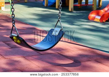 Chain Swing For Children In The Public Playground
