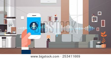 Hand Hold Phone App Intelligent Voice Personal Assistant Recognition Living Room Interior Background