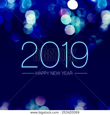 Happy New Year 2019 With Blue Bokeh Light Sparkling On Dark Blue Purple Background,holiday Greeting