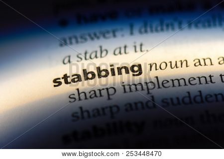 Stabbing Word In A Dictionary. Stabbing Concept.