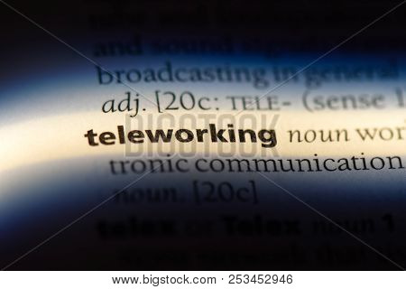 Teleworking Word In A Dictionary. Teleworking Concept.