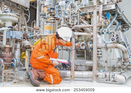 Mechanical engineer checking and inspect lube oil system of centrifugal gas compressor to monitor abnormal condition of system, offshore maintenance services. poster