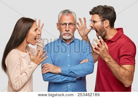 People, Generation And Relationships Concept. Angry Female And Male Gesture And Shout With Madness A
