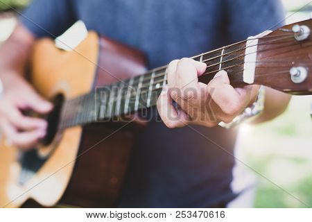 Close Up Of Guitarist Hand Playing Guitar. Musical And Instrument Concept. Outdoors And Leisure Them