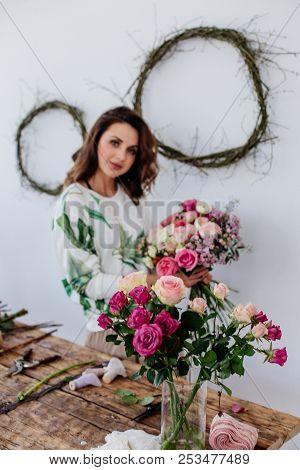 Florist Makes A Bouquet At Light Room.