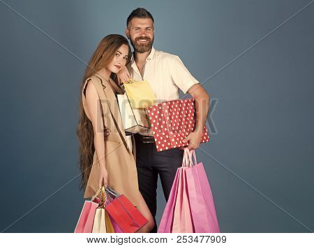 Girl And Bearded Man Hold Present Pack, Cyber Monday. Fashion Shopaholic Couple. Shopping And Sale.