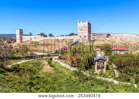 Ruins Of Genoese Fortress In Feodosia, Crimea, Russia. It Is One Of The Tourist Attractions Of Crime