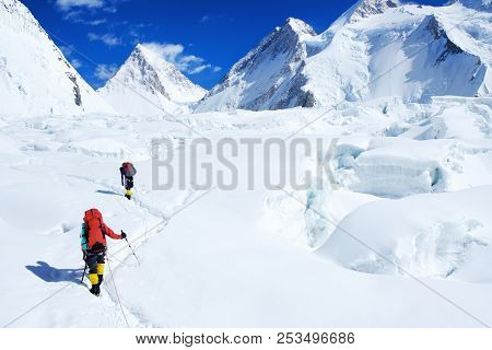 Climber Reaches The Summit Of Everest. Mountain Peak Everest. Highest Mountain In The World. Nationa