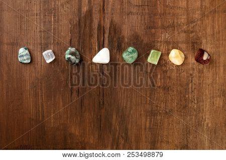 An Overhead Photo Of Gemstones. Healing Stones With Copy Space. Emerald, Selenite, Jasper, Kyanite,