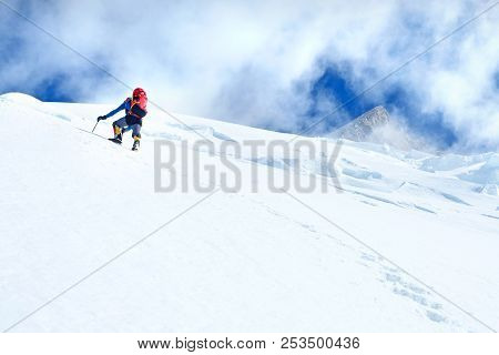 Climber  Reaches The Summit Of Everest. Mountain Peak Everest. Highest Mountain In The World. Nation