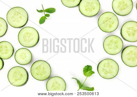 Sliced Cucumber And Mint On White, A Fresh Background With Copyspace