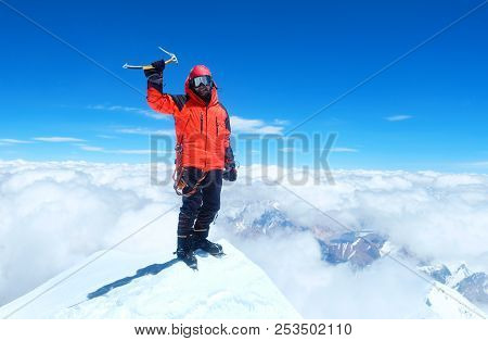 Climber  Reaches The Summit Of Mountain Peak. Success, Freedom And Happiness, Achievement In Mountai