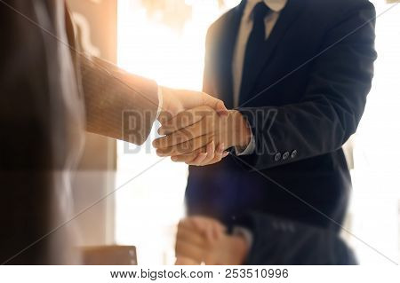 Business Partnership Handshake Concept.photo Two Coworkers Handshaking Process.successful Deal Or Ac