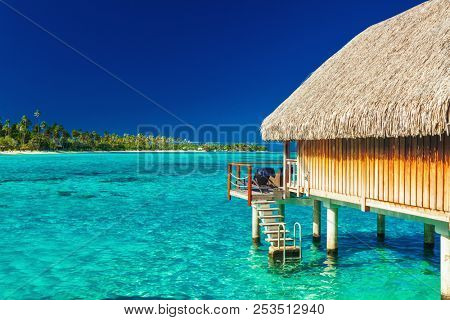 Over water bungalow with steps into amazing lagoon, Moorea, Tahiti