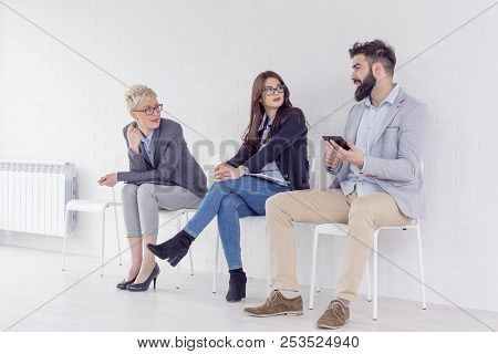 Three People Waiting For Job Interwiev And Talking To Each Other