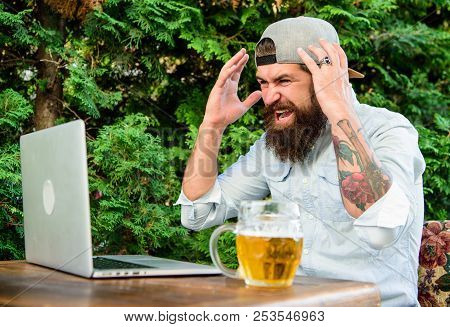 Fan Watch Stream Online While Sit Terrace Outdoors With Beer Mug. Football Fan Bearded Hipster Watch