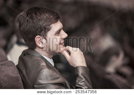 Closeup Of A Young Successful Businessman On A Business Conference, Sitting In The Conference Room