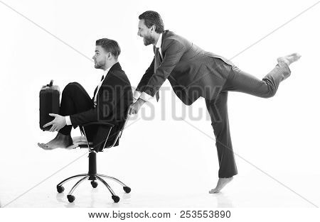 Funny Business, Success Concept. Business People Have Fun And Ride On Office Chair.