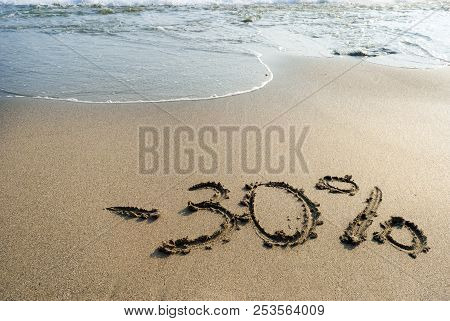 Inscription On The Sand Minus Thirty Percent, - 30 %, Sea Wave On The Sand With The Inscription Thir