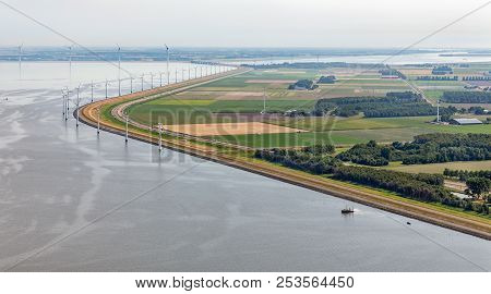 Aerial View Wind Turbines Along Coast Of Flevoland, The Netherlands